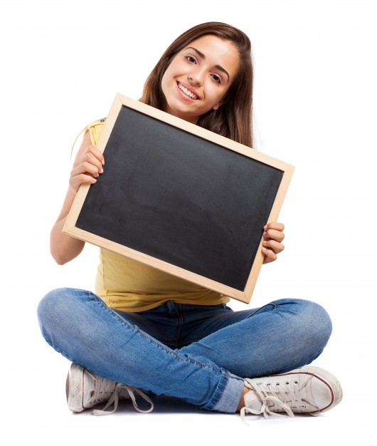 student with crossed legs showing chalkboard 1149 1003